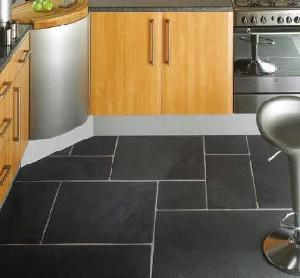 kitchen floor of black ceramic tiles