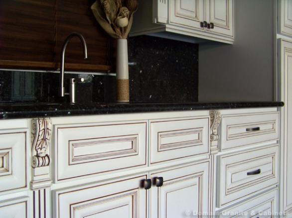 Upgrade the look of white kitchen cabinets by using a glazing