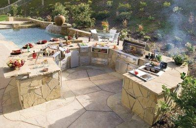 modern outdoor kitchen with oven sink cook top and cabinets